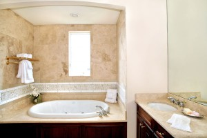 "Travertine Bathtub and countertop with 2"" Backsplash by ADP Surfaces in Orlando Florida"