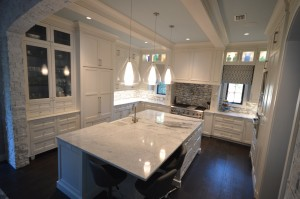 granite countertops, things your should know before purchasing. White granite kitchen countertop with island.