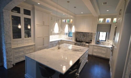 granite countertops, things your should know before purchasing. White granite kitchen countertop with island. by ADP Surfaces in Orlando Florida