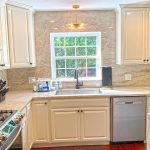Quartzite Kitchen with Full Wrap Around Backsplash and Waterfall Kitchen Island Countertops