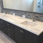 Double Mount, White / Beige bathroom countertop with square undermount sinks and modern wooden cabinets by ADP Surfaces in Orlando Florida