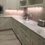White Kitchen Countertops with Cream Cabinets and tile backsplashby ADP Surfaces in Orlando Florida